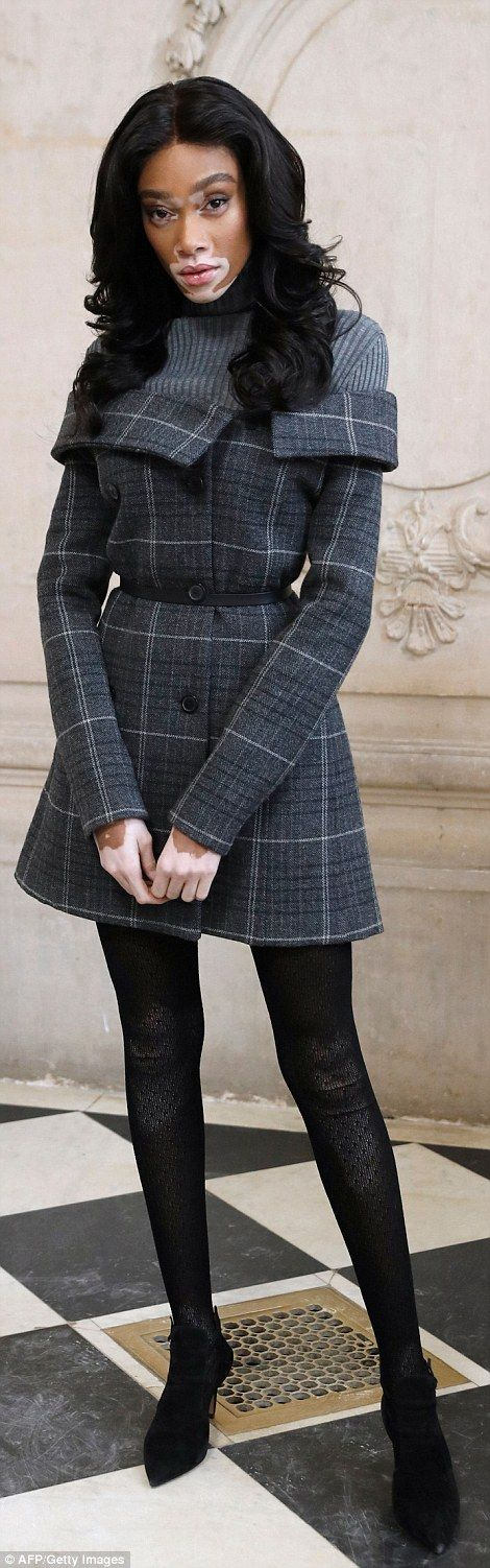 Model moment: Canadian model Winnie Harlow stunned in a thigh-grazing tweed dress...