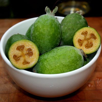 Feijoas.These small green fruits are reminiscent of kiwis. They are egg-shaped, and the inner flesh can be scooped out and eaten along with the pulp and seeds. The texture is similar to a pear while the flavor is slightly citrusy and sweet. Feijoas are best enjoyed when soft and ripe.   - Delish.com