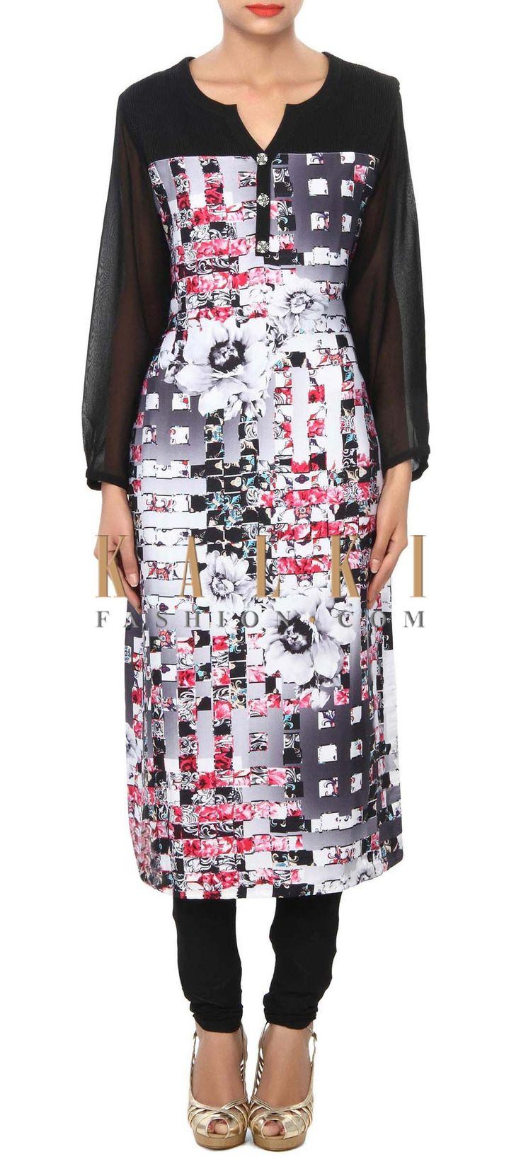 Buy Online from the link below. We ship worldwide (Free Shipping over US$100) Price- $59 Click Anywhere to Tag http://www.kalkifashion.com/black-printed-kurti-enhanced-in-fancy-buttons-only-on-kalki.html