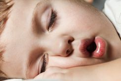 From the moment you bring your newborn home until he's well into the school-aged years, the one thing you're likely to always want more of is sleep. A full night of restful sleep can become so rare that it can almost seem mythical to the parents of toddlers, but there are some things you can do to stretch out the time you're allotted.