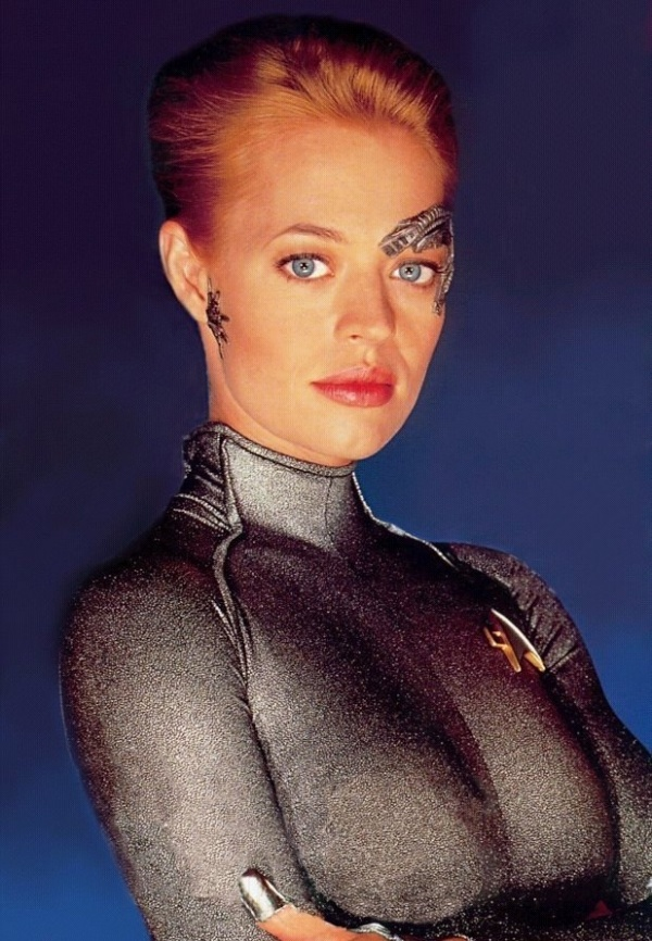 Seven of Nine, full Borg designation: Seven of Nine, Tertiary Adjunct of Unimatrix 01 (Jeri Ryan) was a former Borg drone. She was born Annika Hansen on 2350, the daughter of eccentric exobiologists Magnus and Erin Hansen. She was assimilated by the Borg in 2356 at age six, along with her parents, but was liberated by the crew of the U.S.S. Voyager in 2374. She joined the crew and returned to the Alpha Quadrant with the starship in 2378. Species, Human.