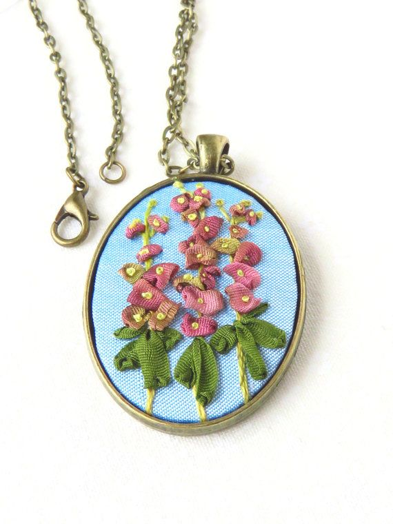 Marg Dier Embroidery.Ribbon embroidery hollyhock flower necklace in pink silk with green and blue with french knots. Beautiful Japanese silk ribbons were the