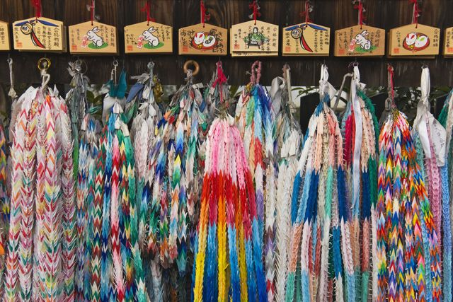 1,000 Paper Cranes: These senbazuru origami cranes with wishes are displayed in the Fushimi Inari Shrine.