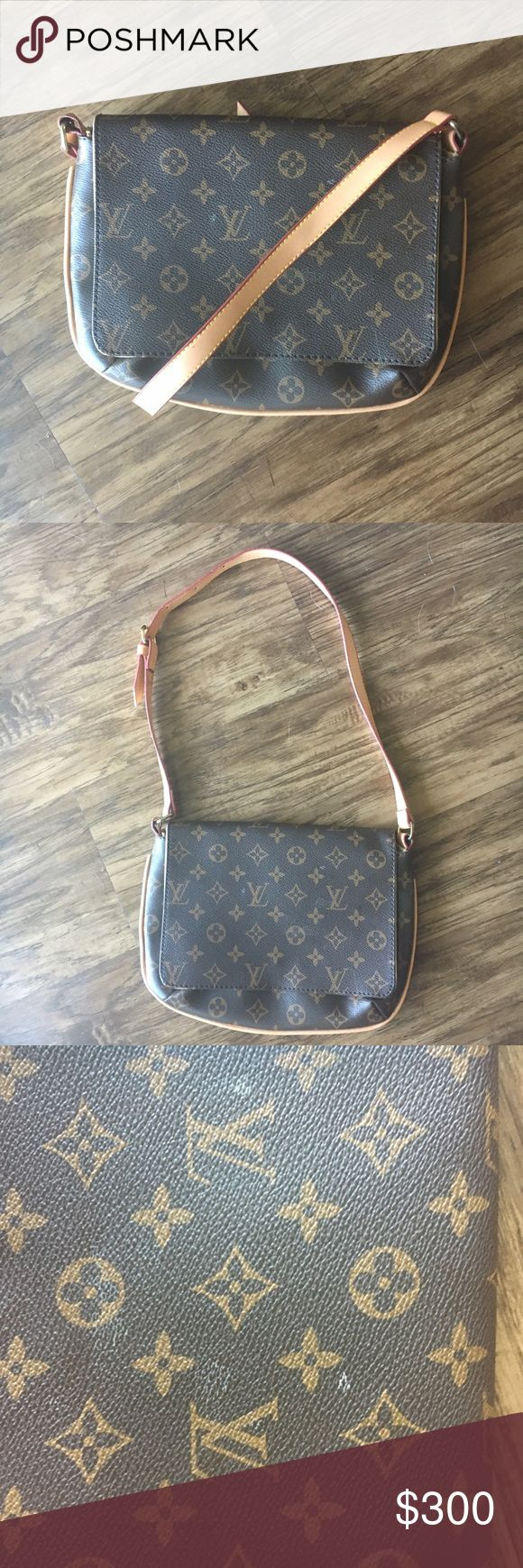 Authentic LV Monogram Musette Tango Short Strap Price negotiable! This is an authentic, well-loved Louis Vuitton purse that still has a lot of life left in it! There are some markings on the leather on the front and the back of the purse (pictured). There is some wear and tear on the shoulder strap and some of the hardware is a little scratched. Purse style is m51257, date code is SD0091. Louis Vuitton Bags