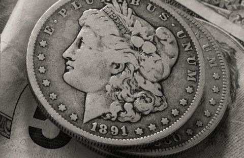 Silver coins are worth much more than face value, such as is the case with this 1891 Morgan silver dollar. photo by glenbledsoe on Flickr.