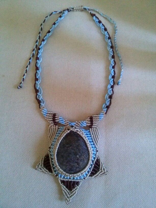African Dinosaur bone in macrame necklace.