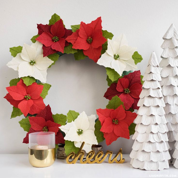 Gorgeous diy crepe paper poinsetta wreath. Pattern and tutorial at www.LiaGriffith.com