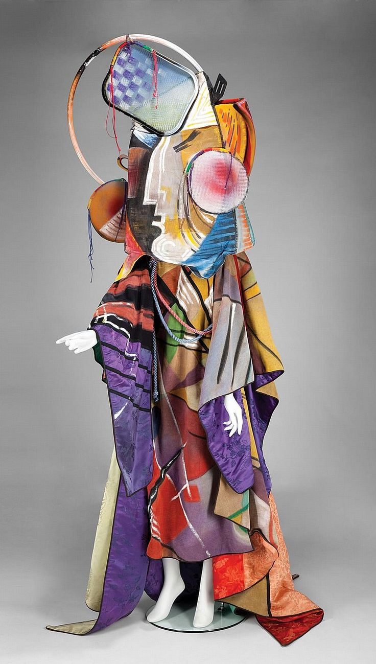 An elaborate, hand painted scenographic scrim kimono with chinese silk multicolored linings with three dimensional abstract head piece. Midler wore this piece during performances of her 1982 through 1983 tour titled De Tour as well as during the televised special Art Or Bust.