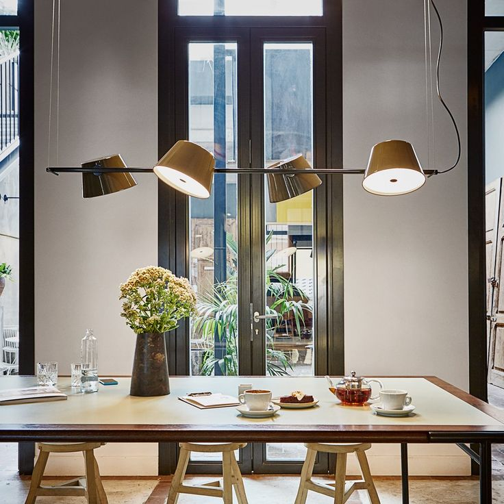 This playful fixture provides direct, indirect, or diffused illumination, depending on the shades' placement. http://www.ylighting.com/marset-tam-tam-4-light-linear-pendant-light.html