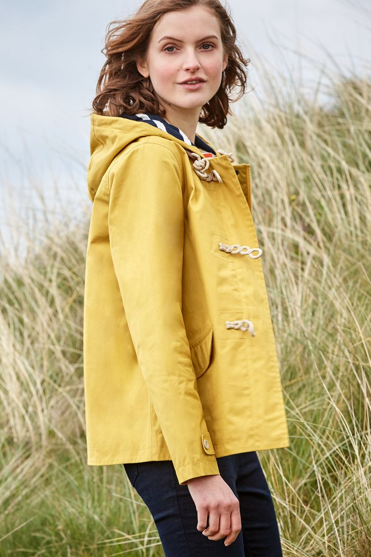 A stylish women's raincoat in famous Seasalt 100% organic cotton Tin Cloth® fabric. Tried & tested on Cornish clifftops & part of the Seasalt RAIN® collection.#SeasaltComfortAndJoy