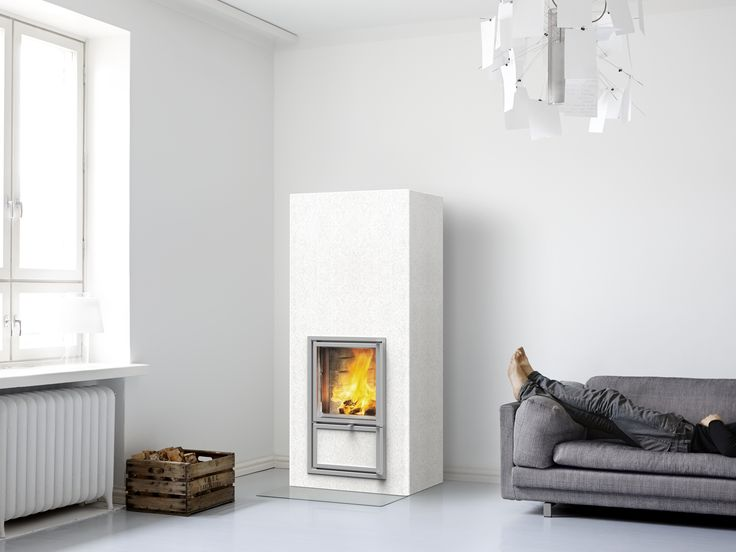 Vaala heat-retaining fireplace. Plastered surface in white. For more info: www.tulikivi.fi