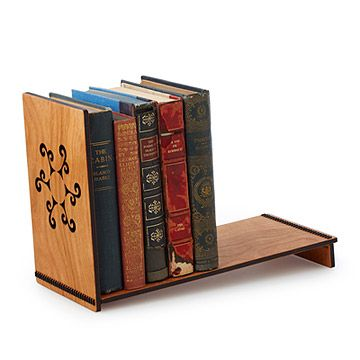 This freestanding bookshelf is designed with just enough tilt to hold books by virtue of gravity.