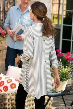 Stripes are just all around fun with our Standout Shirt! Detailed novelty buttons and an asymmetrical hem make this top a fall style stand-out.