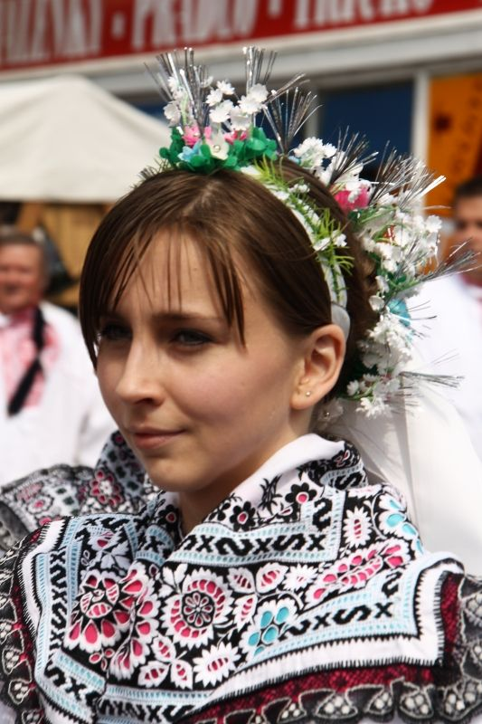 Europe | Portrait of a young woman wearing a traditional headdress, Svatobořic-Mistřína, Moravia, Czech Republic