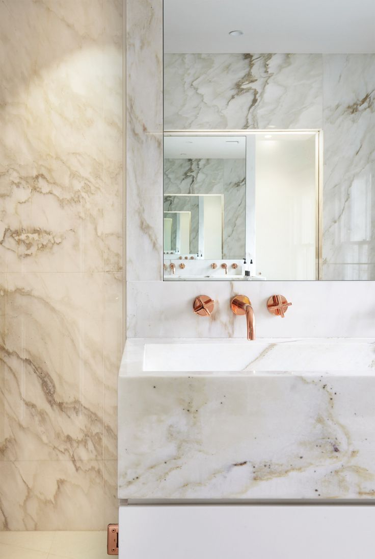 contemporary marble bathroom, metallics, wall hung copper faucet