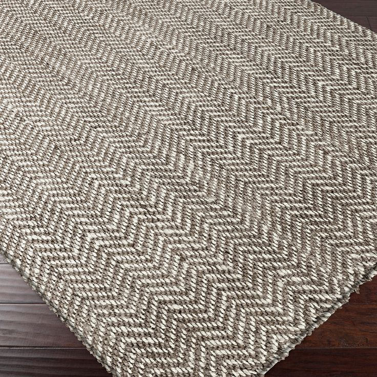 Surya Reeds Charcoal  The hand-woven Surya Reeds rug offers the mod interior timeless texture. Warm in charcoal gray and winter white, a herringbone pattern elicits classic charisma.  •100% jute •Thin pile •Rug pad recommended •Available in several sizes