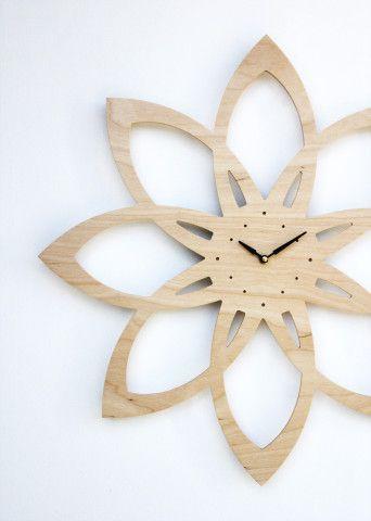 Mid-century modern inspired sunburst clock (maybe not laser-cut but nice inspiration work!)