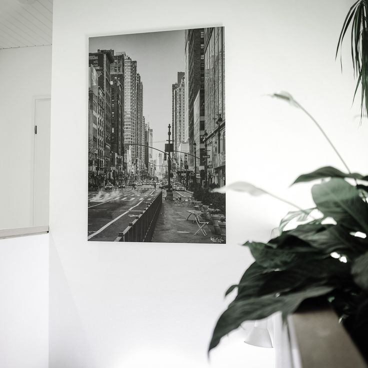 Large 95 x 135 cm brushed aluminum black & white print on a staircase wall.