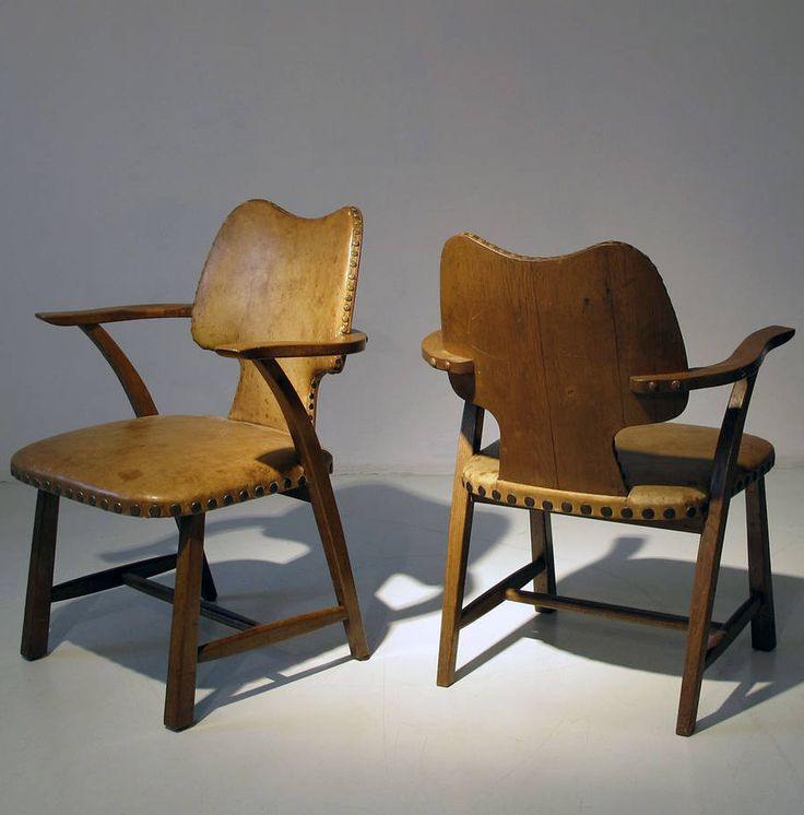 Ernst Kaltenbach; Oak and Leather Armchairs, 1950s.