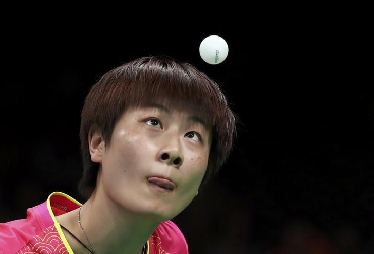 OLYMPICS-RIO-TABLETENNIS-W-SINGLES 2016 Rio Olympics - Table Tennis - Quarterfinals - Women's Singles - Riocentro - Pavilion 3 - Rio de Janeiro, Brazil - 09/08/2016. Ding Ning (CHN) of China sticks out her tongue during play against Ying Han (GER) of Germany. REUTERS/Kai Pfaffenbach
