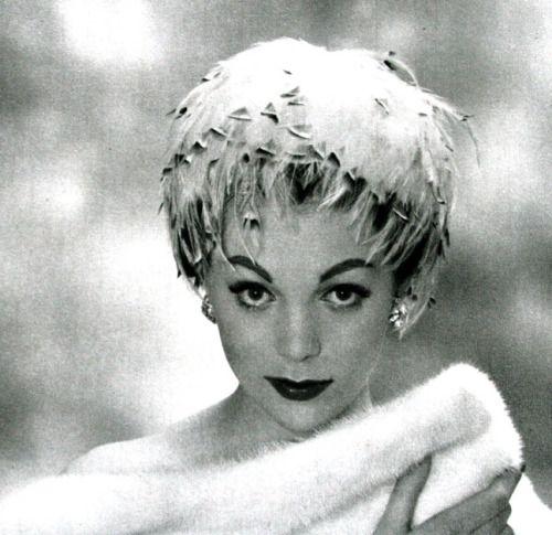Model wearing a feather headband wig by Jane Blanchot, L'Officiel, December 1958