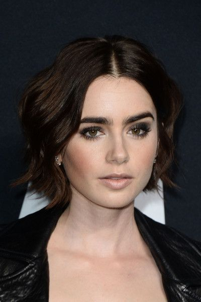 Lily Collins Short Wavy Cut - Lily Collins was a cutie at the Saint Laurent show with her short wavy 'do.