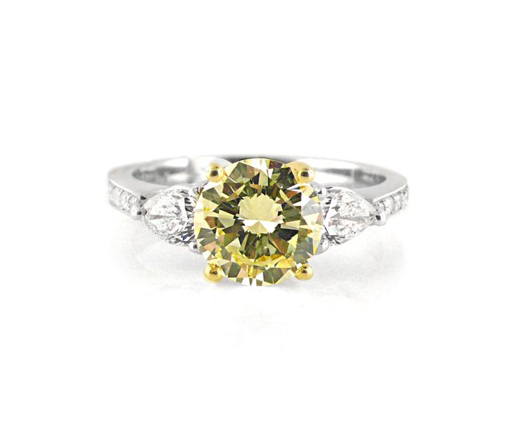 An 18ct Yellow and White Gold Yellow Diamond and Pear Shaped Diamond Trilogy Ring