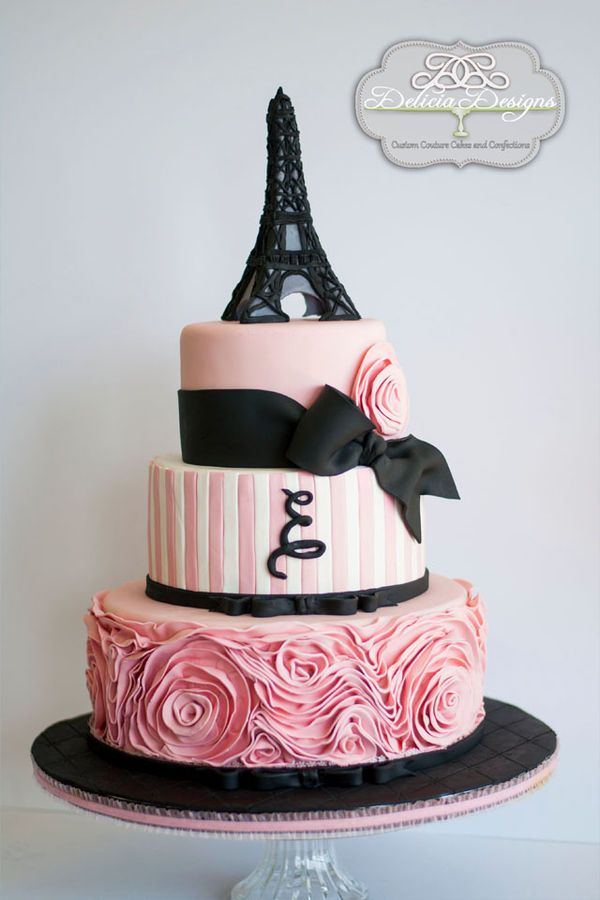 A Parisian glamour cake topped with a fondant Eiffel Tower.