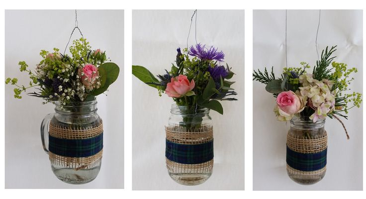 Hanging pots with rose, gypsophila, hydrangea and centaurea cut offs from bridal and bridesmaids bouquets. Pretty to hang them and decorate an empty space. Scottish ribbon for scottish wedding :)