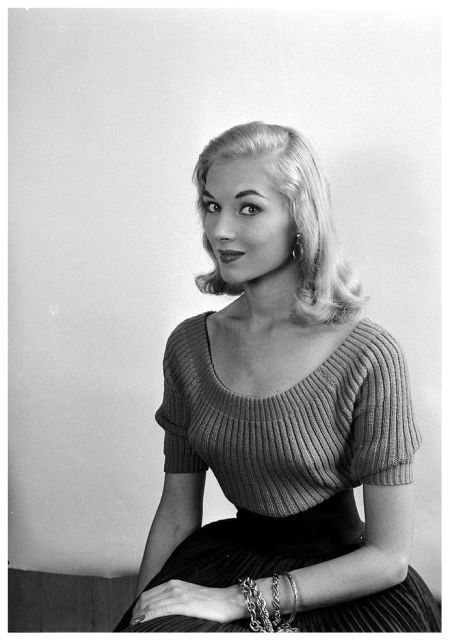 Vikki Dougan. photo by Nina Leen, July 1952.  She...kind of has the same look on her face as Aurora in the Disney sleeping beauty doesn't she?! Wow! I've never seen a live person resemble that character so much!