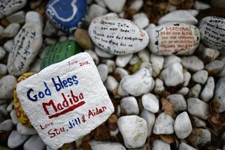 "Stones inscribed with ""get well"" messages are left outside the home of former President Nelson Mandela in Johannesburg"