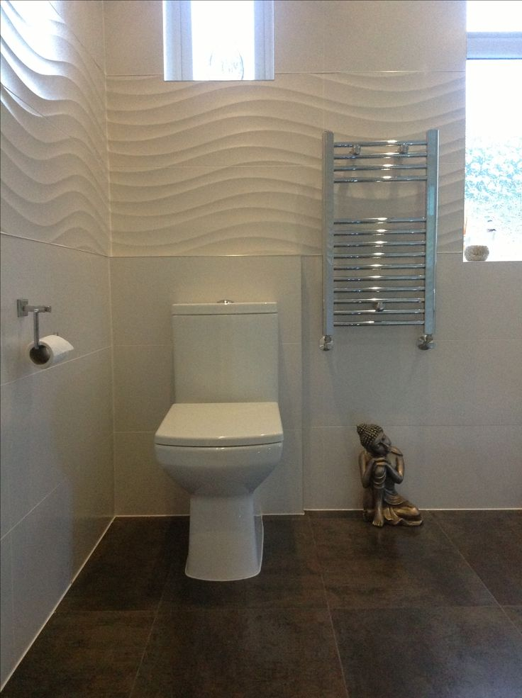 Fresh white bathroom tiles with feature wave design tiles