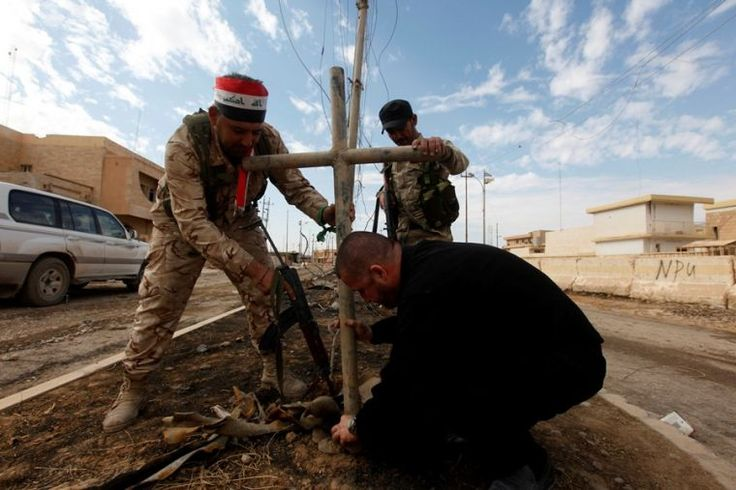 Christians Shed Tears of Joy as Cross, Symbol of Christ's Victory Over Evil, Is Back in Iraq | Christian News on Christian Today