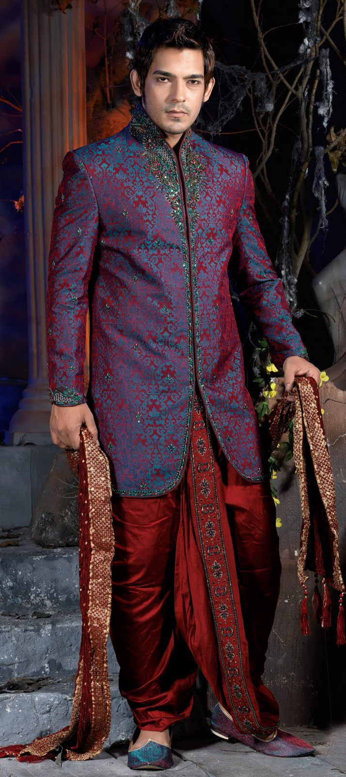 11327: Red and Maroon color family Dhoti Sherwani.