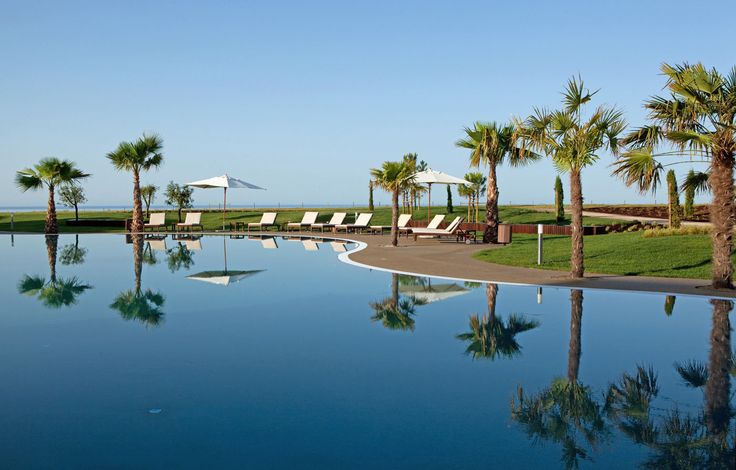 Cascade Wellness & Lifestyle Resort Lagos, Portugal Beachfront Grounds Resort sky tree marina Nature dock arecales Beach swimming pool Lagoon palm Sea shore Lake surrounded day