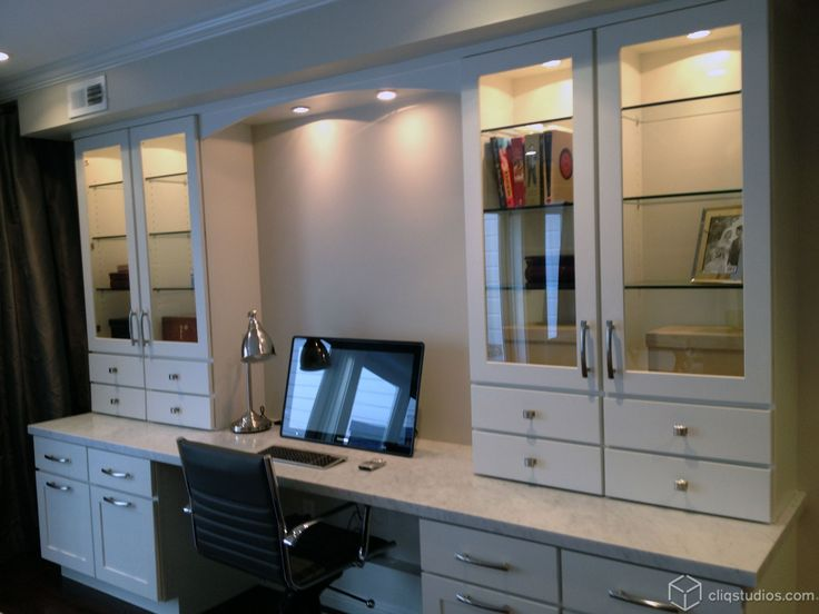 A Built In Desk With White Shaker Kitchen Cabinets From