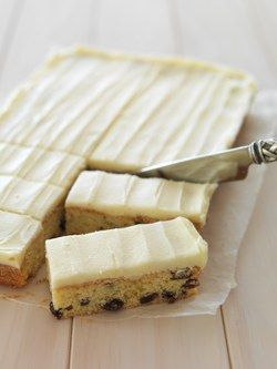 125g butter, softened 2/3 cup sugar 2 eggs, room temperature 1 teaspoon each: vanilla essence, finely grated lemon zest 1 1/3 cups self-raising flour 1 cup sultanas Icing 50g butter, softened 2 cup...
