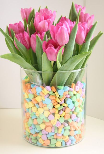 Valentine's Day centerpiece idea - pink tulips in vase filled with pastel candy hearts
