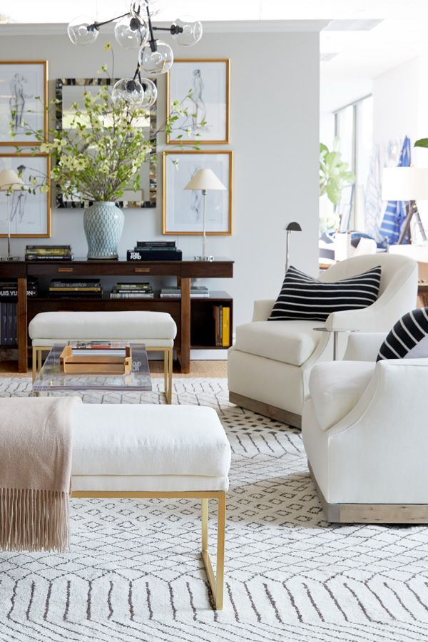 patterned rug in white neutral living room brass bench