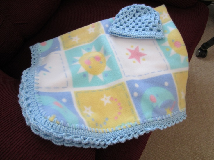 Fleece blanket with crocheted edge.  Matching crocheted baby hat.