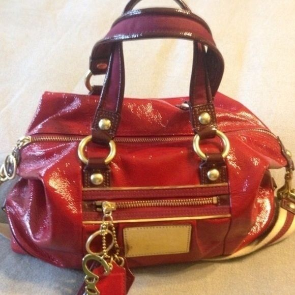 Red Coach Poppy Purse Red Coach Poppy Purse . It is in great condition. Bright red textured patent  leather with bordeaux handles and accents. Pockets on the inside and a zipper pocket on the outside. Shoulder strap as well as short handles. #coachpurse #redpurse #coachpoppy #Musthave #spring #essential #trending #European #chic #ootd #trendy #blogger #redleather #fashion #fashionista #Datenight #goingout #coach Coach Bags Shoulder Bags