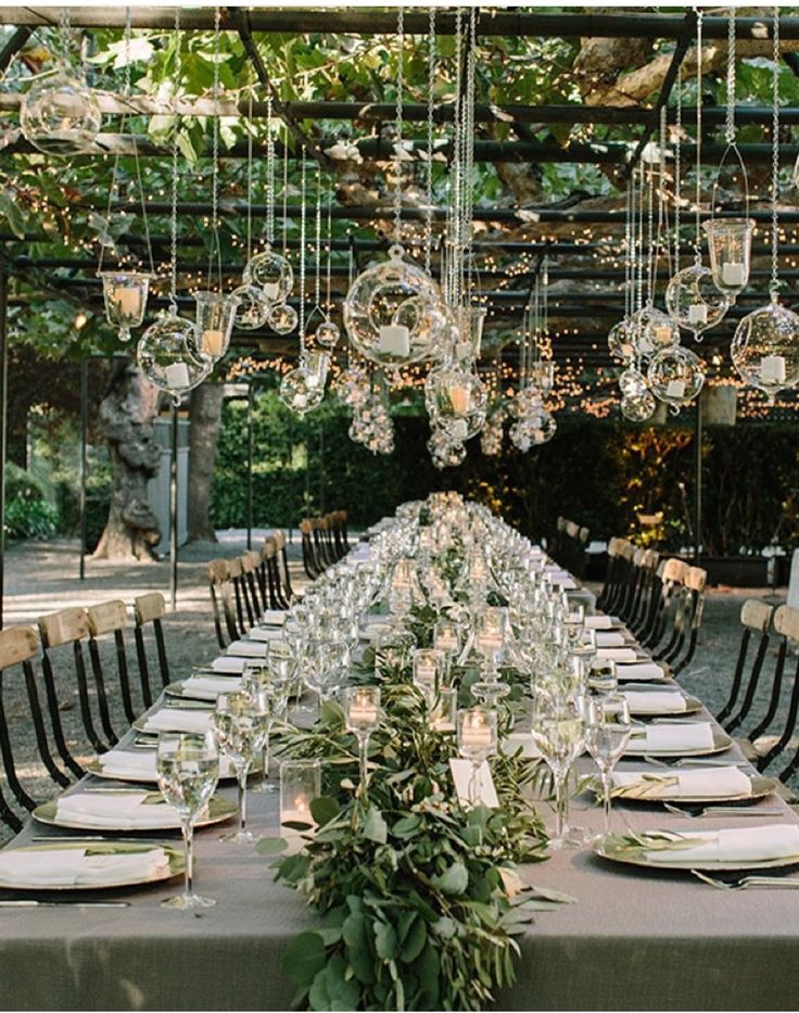 wedding decor - garlands along table + hanging votives and lights