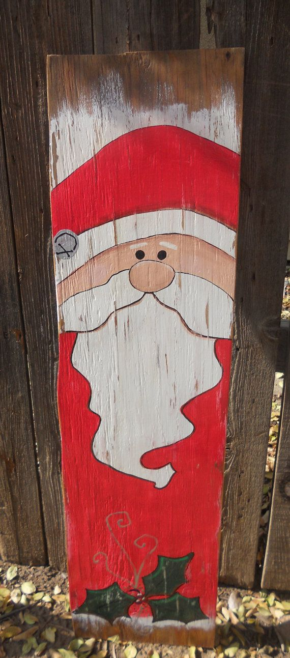 This is a 40 tall and 10.5 wide hand painted Santa on wood. It has a picture frame hanger on the back for hanging or it would be great leaned against a wall on the porch. This is a one of a kind decoration complete with rosy cheeks and holly leaves.    Please send me a message if you have any questions