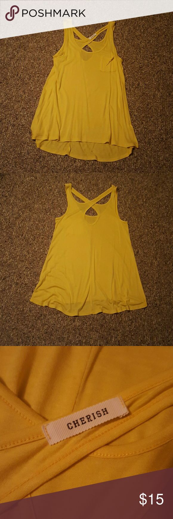 Nwot Yellow tank. This is a yellow cotton criss cross back ankle with a little stretch. It has a high low bottom and very comfy to wear. Cherish Tops Tank Tops