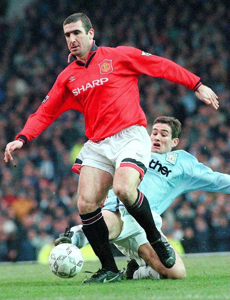 Utd's Eric Cantona escapes a Nigel Clough tackle. Manchester United v Manchester City 18/2/96