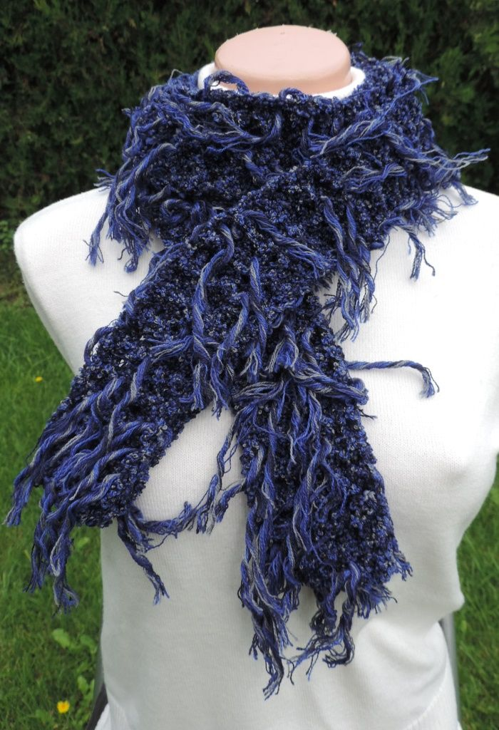 "Very interesting unusual scarf, soft to the touch and well worn. Fancy yarn with tassels which creates a unique look :-) Measurement: Scarflette length is ~ 54"" (~ 140 cm.) Composition: - 43% Lana Merino Wool, 42% Acrylic and 15% Polyamide - blue color - unisex. Handmade with ♥ $10.42 USD"