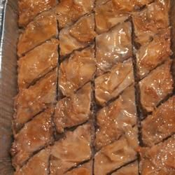 Easy Baklava Recipe ~ Phyllo dough is layered with butter, cinnamon and nuts and baked, then topped with a honey syrup and allowed to cool before eating.