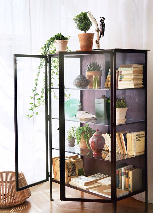 glass and black metal cabinet decorated with books and plants / sfgirlbybay - 25+ Best Ideas About Metal Bookcase On Pinterest Bookcase
