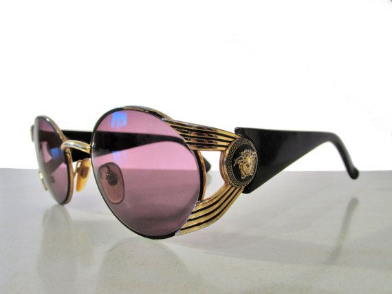 Check out this item in my Etsy shop https://www.etsy.com/listing/498331872/vintage-gianni-versace-medusa-sunglasses