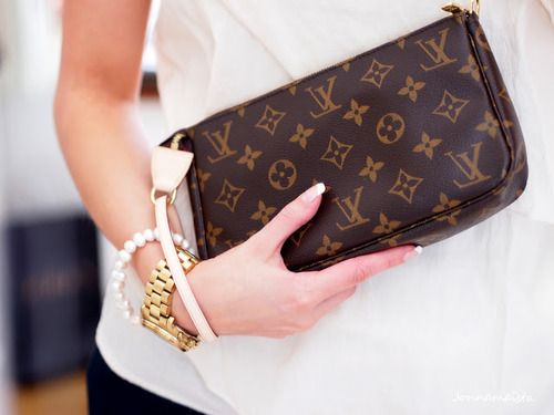 Louis Vuitton.  This is what I use for my make-up bag. I use this when I travel -great size to slip in and out of purse.